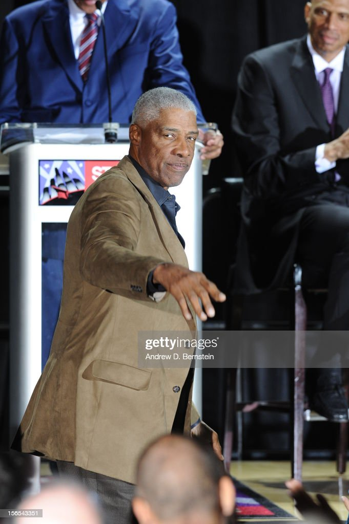 Julius Erving acknowledges the crowd at a statue unveiling ceremony for Kareem Abdul-Jabbar at Staples Center on November 16, 2012 in Los Angeles, California.