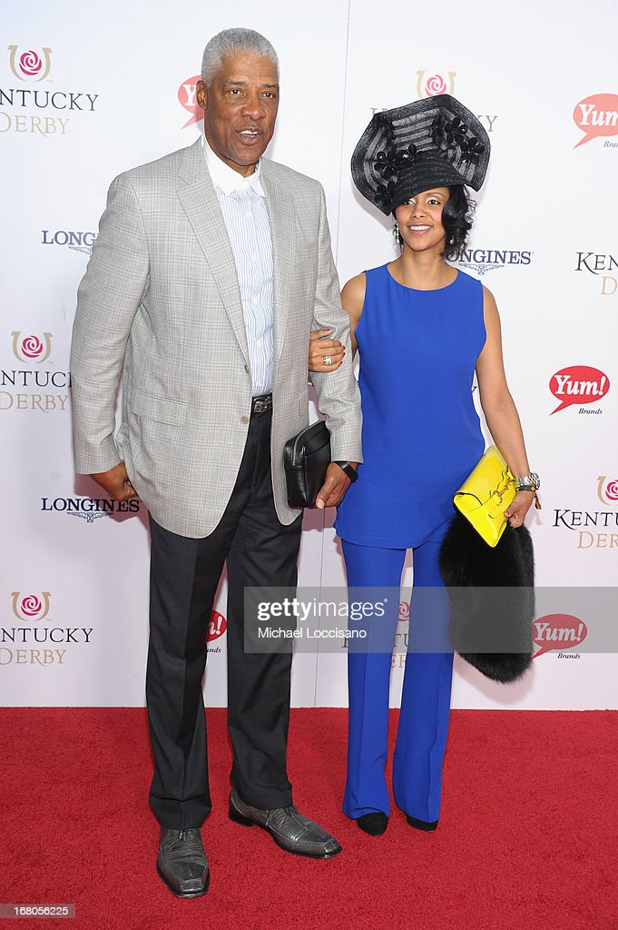 Julius Erving and Dorys Madden attend the 139th Kentucky Derby at Churchill Downs on May 4, 2013 in Louisville, Kentucky.