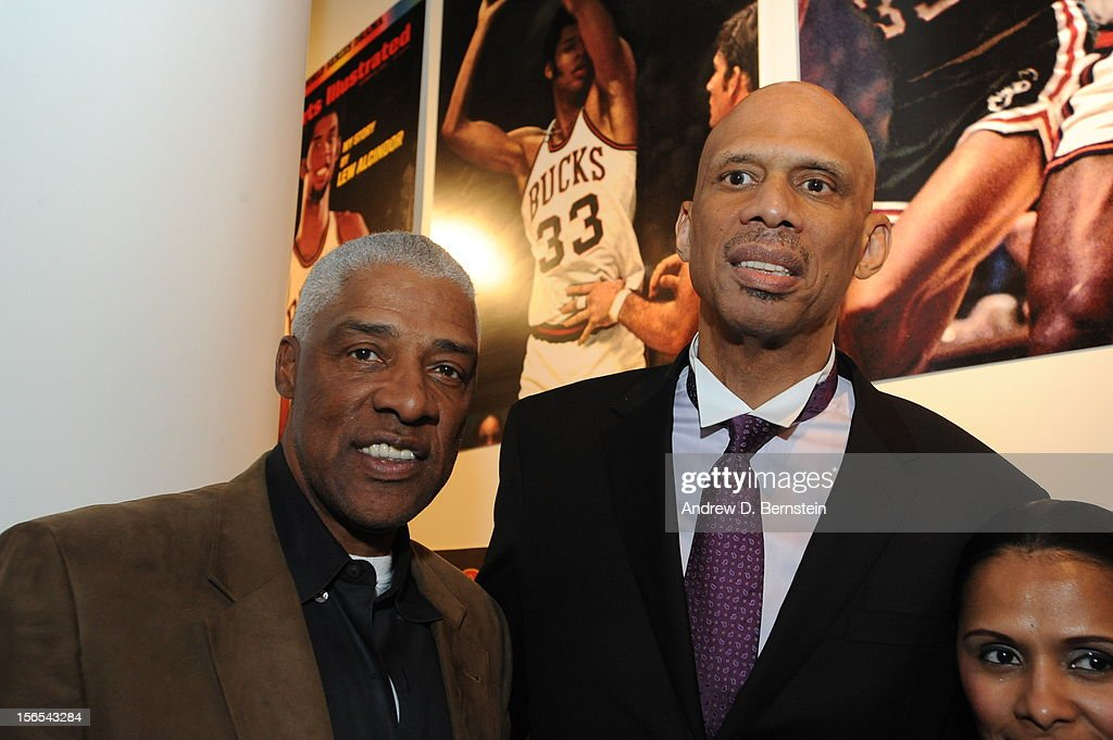Julius Erving and Kareem Abdul-Jabbar pose for a photograph after a statue unveiling ceremony at Staples Center on November 16, 2012 in Los Angeles, California.