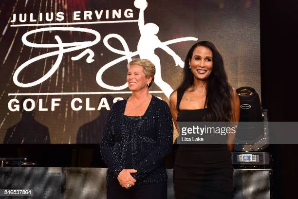 Julius Erving brings Ann Myers Drysdale and Beverly Johnson onstage to personally thank them during the Erving Golf Classic Black Tie Ball sponsored...