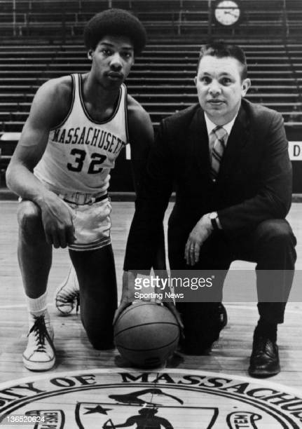 Julius Erving of the Massachusetts Minutemen poses for a portrait with his head coach Jack Leaman circa 1970 at the Curry Hicks Cage in Amherst...