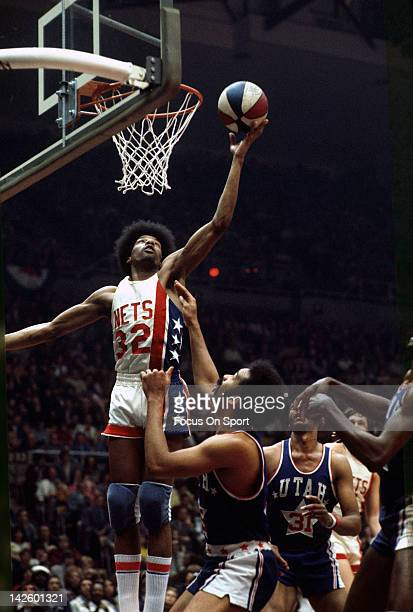 Julius Erving of the New Jersey Nets lays the ball up against the Utah Stars during an ABA basketball game circa 1974 at the Rutgers Athletic Center...