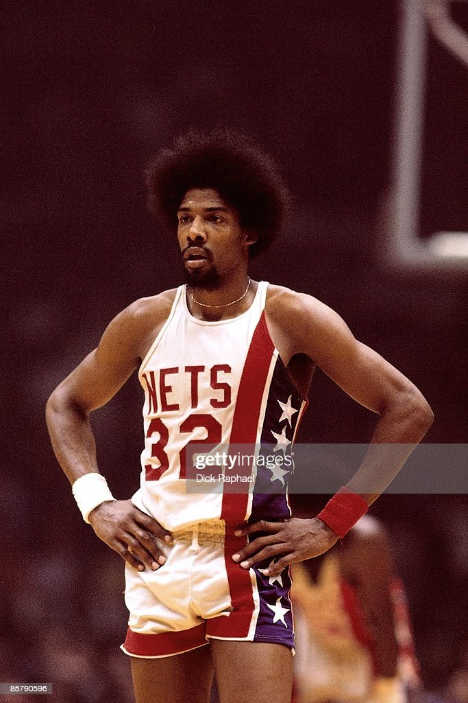 Julius Erving of the New Jersey Nets looks on during a game against the Boston Celtics played in 1968 at the Boston Garden in Boston Massachusetts...