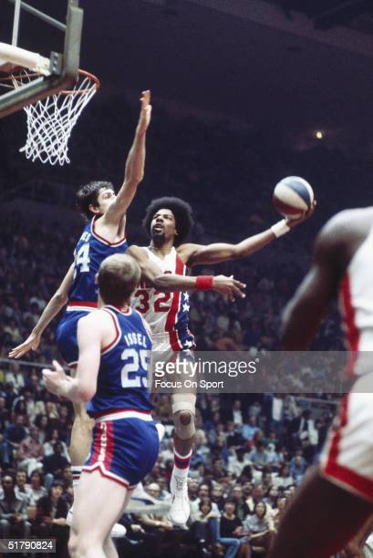 Julius Erving of the New York Nets drives to the basket during a game against the Kentucky Colonels at the Nassau Coliseum circa 1970's in Uniondale...