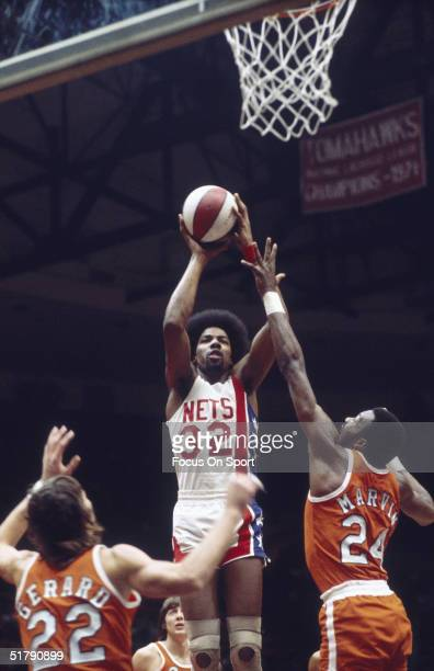 Julius Erving of the New York Nets makes a jumpshot during a game against the Spirits of St Louis at the Nassau Coliseum circa 1970's in Uniondale...