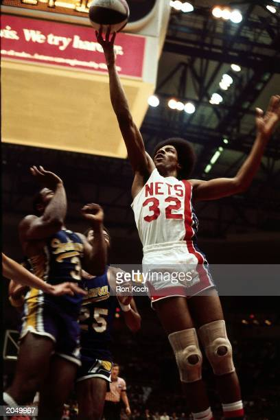 Julius Erving of the New York Nets soars to the basket against the Indiana Pacers during an ABA game at the Nassau Veterans Memorial Coliseum in 1974...
