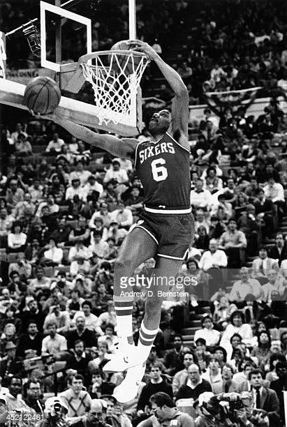 Julius Erving of the Philadelphia 76ers attempts a dunk during the 1985 NBA Slam Dunk Contest on February 9 1985 at Market Square Arena in...