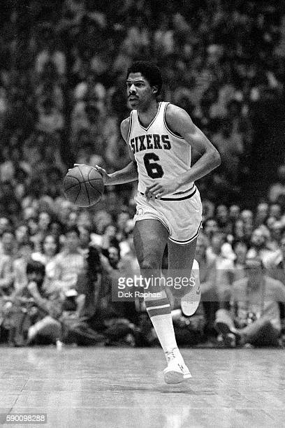 Julius Erving of the Philadelphia 76ers dribbles the ball up court during a game at The Spectrum in Philadelphia Pennsylvania circa 1982 NOTE TO USER...