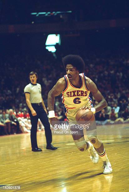 Julius Erving of the Philadelphia 76ers dribbles the ball up court during an NBA basketball game circa 1978 at The Spectrum in Philadelphia...