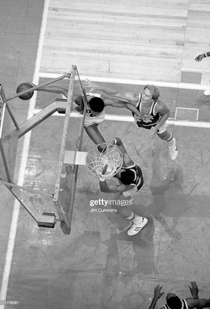 Julius Erving of the Philadelphia 76ers drives to the basket in what becomes known as 'The Move' against Mark Landsberger and Kareem AbdulJabbar of...