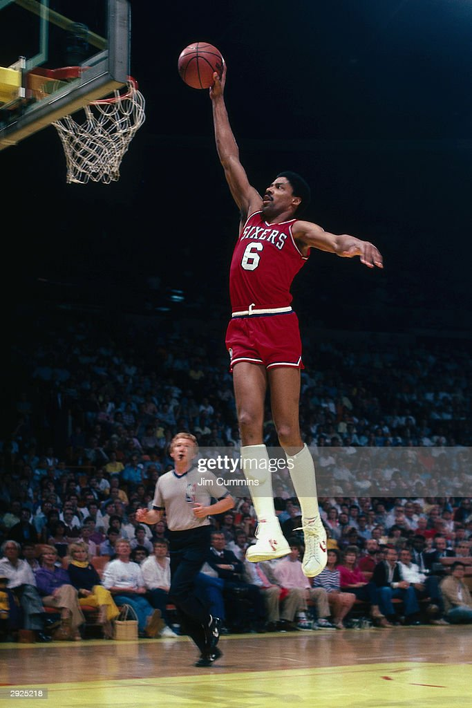 Julius Erving of the Philadelphia 76ers goes for a dunk against the Los Angeles Lakers during a game circa 1986 at the Great Western Forum in...