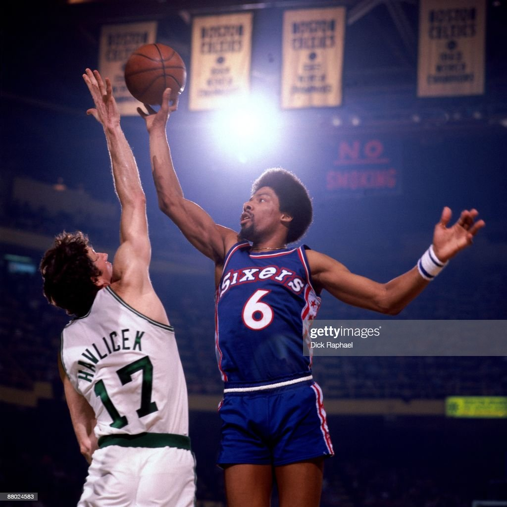 Julius Erving of the Philadelphia 76ers goes up for a shot against John Havlicek of the Boston Celtics during a game played in 1975 at the Boston...