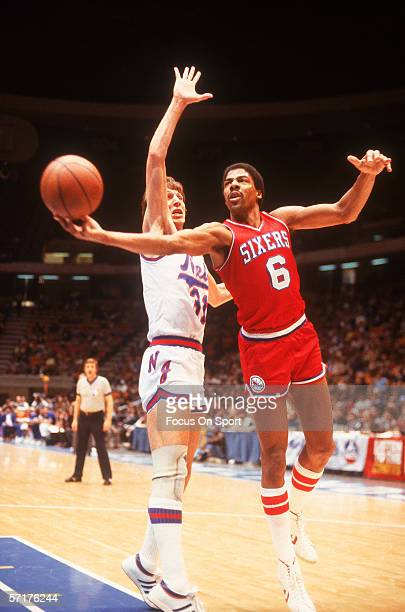 Julius Erving of the Philadelphia 76ers jumps and shoots against the New Jersey Nets circa the 1970's during a game
