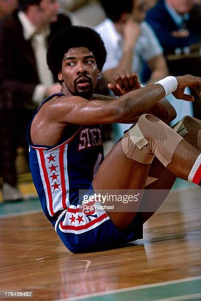 Julius Erving of the Philadelphia 76ers looks for a call from the ground during a game played circa 1977 at the Boston Garden in Boston Massachusetts...
