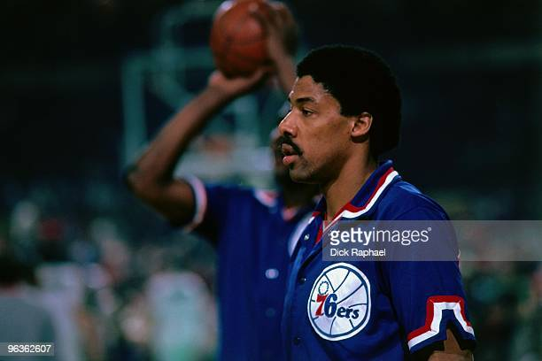Julius Erving of the Philadelphia 76ers looks on against the Boston Celtics during a game played in 1981 at the Boston Garden in Boston Massachusetts...