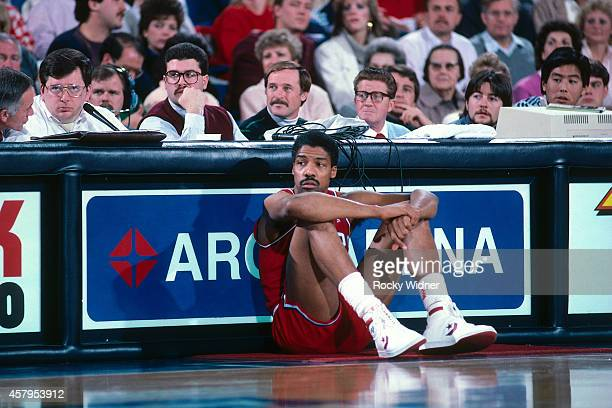 Julius Erving of the Philadelphia 76ers looks on against the Sacramento Kings on December 27 1986 at Arco Arena in Sacramento California NOTE TO USER...