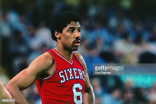 Julius Erving of the Philadelphia 76ers looks on during a game against the Boston Celtics played in 1981 at the Boston Garden in Boston Massachusetts...