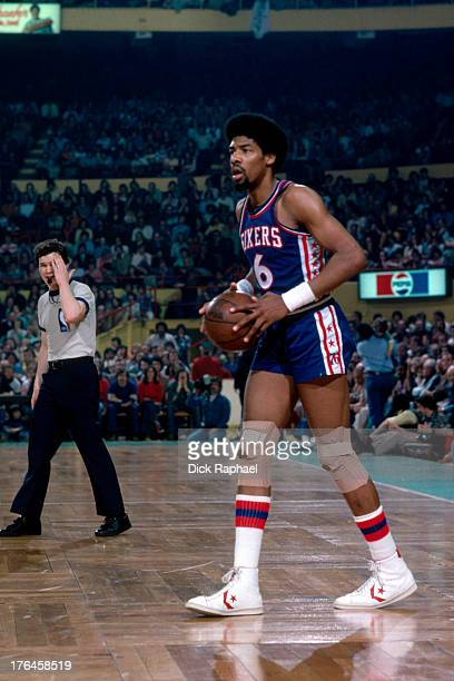 Julius Erving of the Philadelphia 76ers looks to pass the ball during a game played circa 1977 at the Boston Garden in Boston Massachusetts NOTE TO...