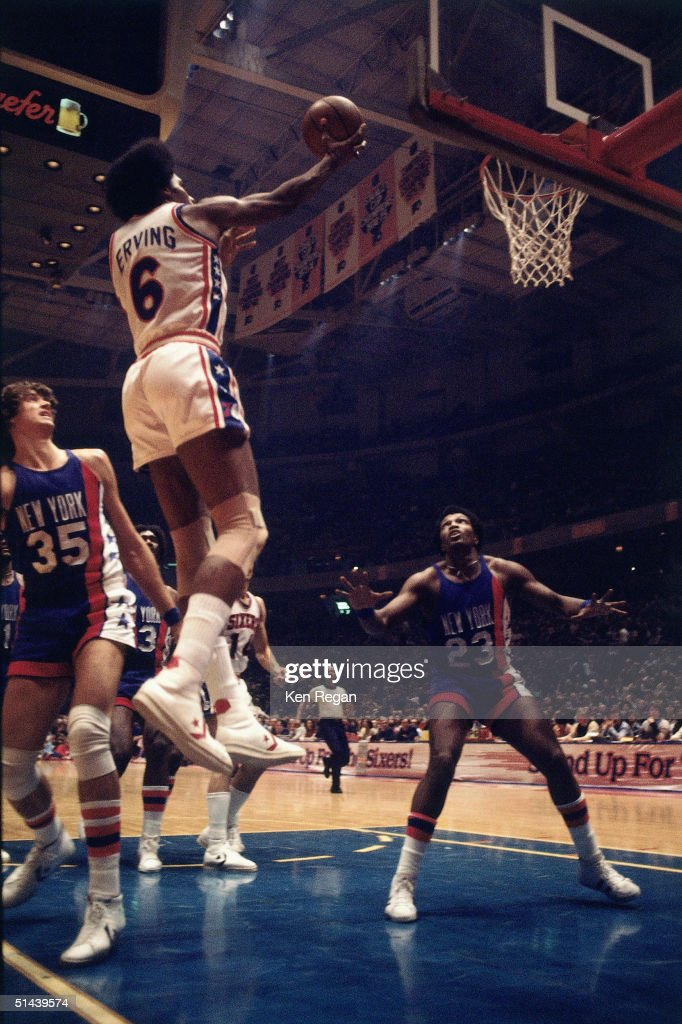 Julius Erving of the Philadelphia 76ers shoots a lauyp against the New York Nets during an NBA game in 1977 at the Spectrum in Philadelphia...