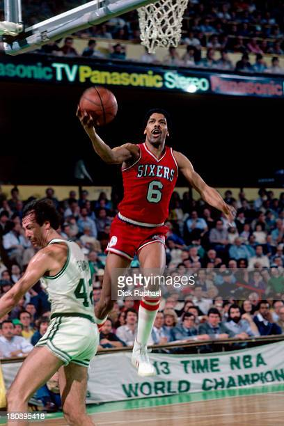Julius Erving of the Philadelphia 76ers shoots a layup during a game against the Boston Celtics circa 1981 at the Boston Garden in Boston...