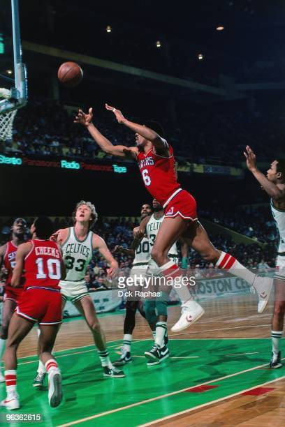 Julius Erving of the Philadelphia 76ers shoots a layup during a game against the Boston Celtics played in 1981 at the Boston Garden in Boston...