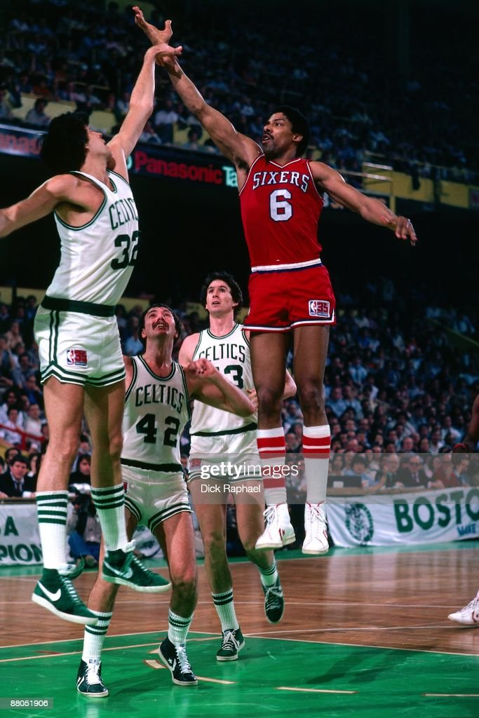 Julius Erving of the Philadelphia 76ers shoots a layup over Kevin McHale of the Boston Celtics in Game Five of the Eastern Conference Finals during...