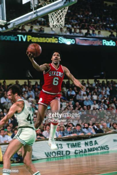 Julius Erving of the Philadelphia 76ers shoots against the Boston Celtics during a game played circa 1975 at the Boston Garden in Boston...
