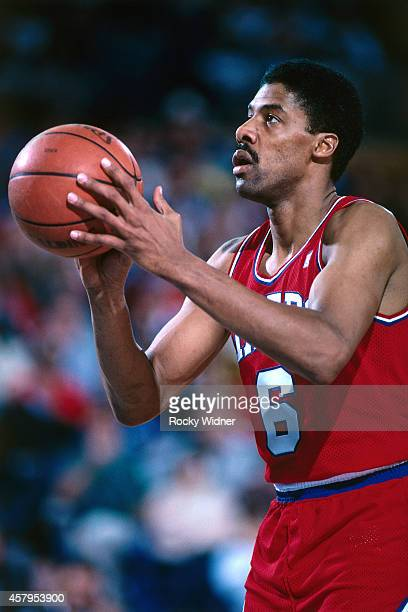 Julius Erving of the Philadelphia 76ers shoots against the Sacramento Kings on December 27 1986 at Arco Arena in Sacramento California NOTE TO USER...