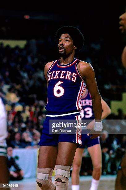 Julius Erving of the Philadelphia 76ers stretches on the court during the game against the Boston Celtics played in 1977 at the Boston Garden in...