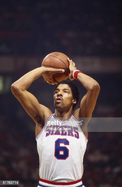 Julius Erving of the Philadelphia 76ers throws from the freethrow line against the Boston Celtics at the Spectrum during the 19851986 NBA season in...