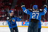 Julius Honka of Team Finland celebrates his goal with teammates in a preliminary round game during the 2015 IIHF World Junior Hockey Championships...
