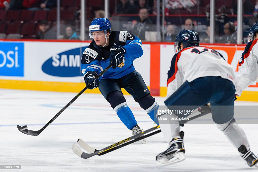 <a gi-track='captionPersonalityLinkClicked' href=/galleries/search?phrase=Julius+Honka&family=editorial&specificpeople=9966154 ng-click='$event.stopPropagation()'>Julius Honka</a> #9 of Team Finland looks to play the puck during the 2015 IIHF World Junior Hockey Championship game against Team Slovakia at the Bell Centre on December 27, 2014 in Montreal, Quebec, Canada.