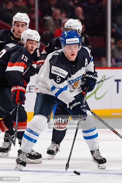 Julius Honka of Team Finland looks to play the puck during the 2015 IIHF World Junior Hockey Championship game against Team United States at the Bell...