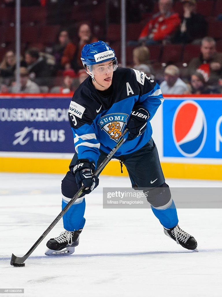 <a gi-track='captionPersonalityLinkClicked' href=/galleries/search?phrase=Julius+Honka&family=editorial&specificpeople=9966154 ng-click='$event.stopPropagation()'>Julius Honka</a> #9 of Team Finland looks to play the puck in a preliminary round game during the 2015 IIHF World Junior Hockey Championships against Team Germany at the Bell Centre on December 31, 2014 in Montreal, Quebec, Canada. Team Finland defeated Team Germany 2-0.