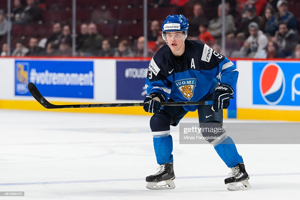 <a gi-track='captionPersonalityLinkClicked' href=/galleries/search?phrase=Julius+Honka&family=editorial&specificpeople=9966154 ng-click='$event.stopPropagation()'>Julius Honka</a> #9 of Team Finland skates in a preliminary round game during the 2015 IIHF World Junior Hockey Championships against Team Germany at the Bell Centre on December 31, 2014 in Montreal, Quebec, Canada. Team Finland defeated Team Germany 2-0.