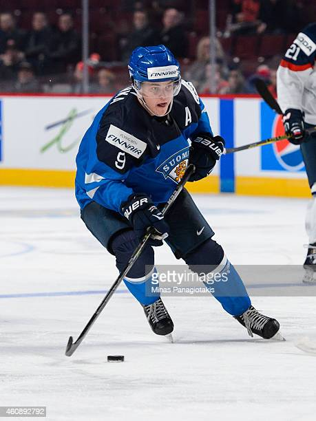Julius Honka of Team Finland skates with the puck during the 2015 IIHF World Junior Hockey Championship game against Team Slovakia at the Bell Centre...