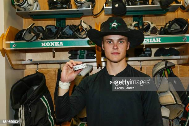 Julius Honka of the Dallas Stars poses with the puck from his first NHL goal after a win against the Arizona Coyotes at the American Airlines Center...