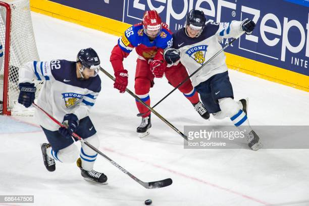 Julius Honka vies with Nikita Kucherov during the Ice Hockey World Championship Bronze medal game between Russia and Finland at Lanxess Arena in...