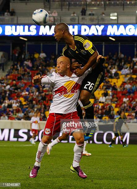 Julius James of the Columbus Crew heads the ball over Luke Rodgers of the New York Red Bulls on June 4 2011 at Red Bull Arena in Harrison New Jersey...