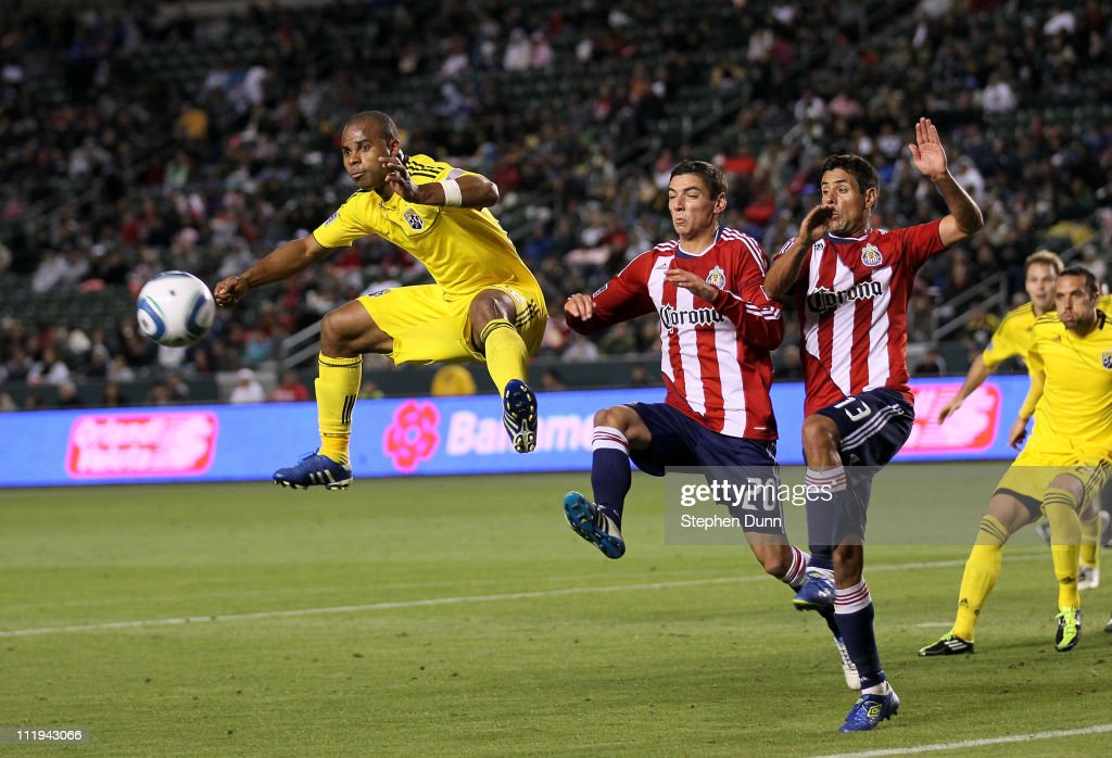 Julius James of the Columbus Crew jumps for a free kick against Zarek Valentin and Ante Jazic of Chivas USA at The Home Depot Center on April 9 2011...