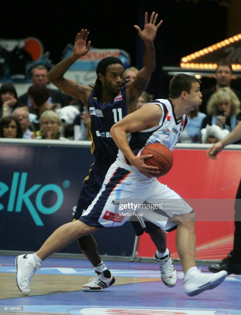 Julius Jenkins of Alba and Jan Lipke of Bremerhaven in action during the German Basketball Championships PlayOffs second game between Eisbaeren...