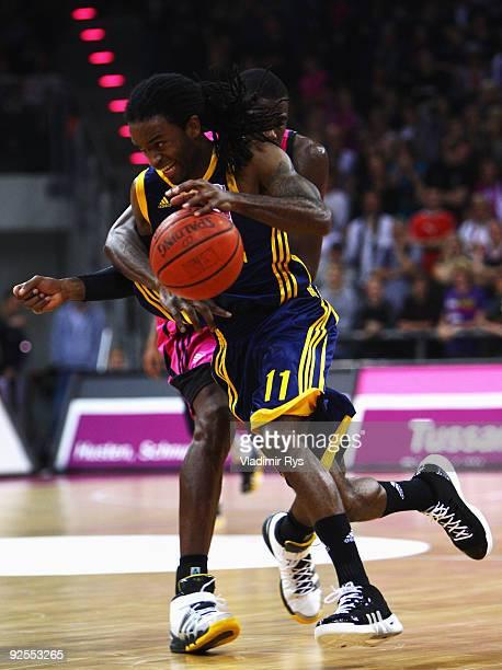 Julius Jenkins of Alba passes over Patrick Flomo of Baskets during the Beko Basketball Bundesliga game between Telekom Baskets and Alba Berlin at...