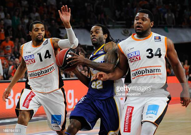 Julius Jenkins of Oldenburg is challenged by Lance Jeter of Ulm and Allan Ray of Ulm during the fourth Game of the semifinals of the Beko Basketball...