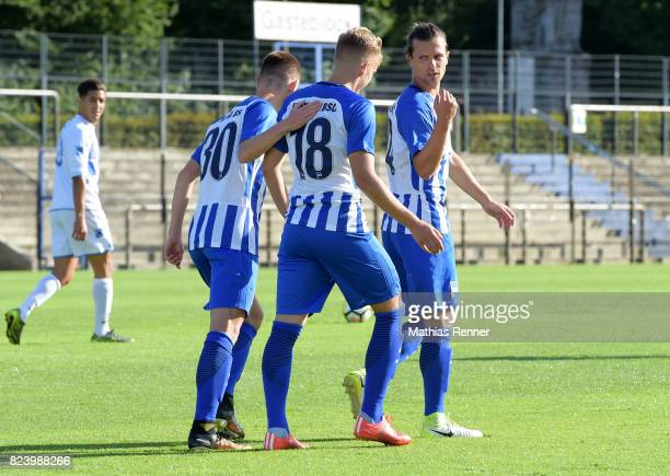 Julius Kade Sinan Kurt and Valentin Stocker of Hertha BSC celebrate the goal during the test match between Hertha BSC and Club Italia Berlino on july...