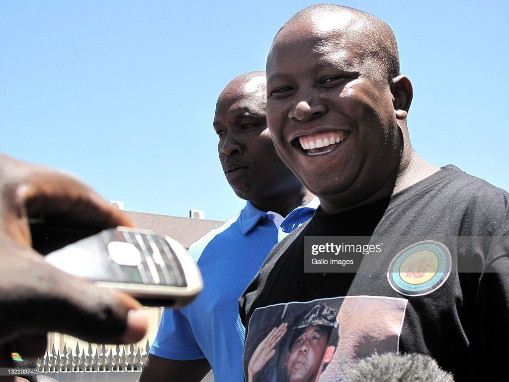 <a gi-track='captionPersonalityLinkClicked' href=/galleries/search?phrase=Julius+Malema&family=editorial&specificpeople=5866727 ng-click='$event.stopPropagation()'>Julius Malema</a>, ANC youth league president, addresses his supporters following his suspension from the ANC on November 10, 2011 in Polokwane, South Africa. Malema was found guilty and suspended from the ANC for five years for 'hurting the party and South Africa's reputation abroad'.