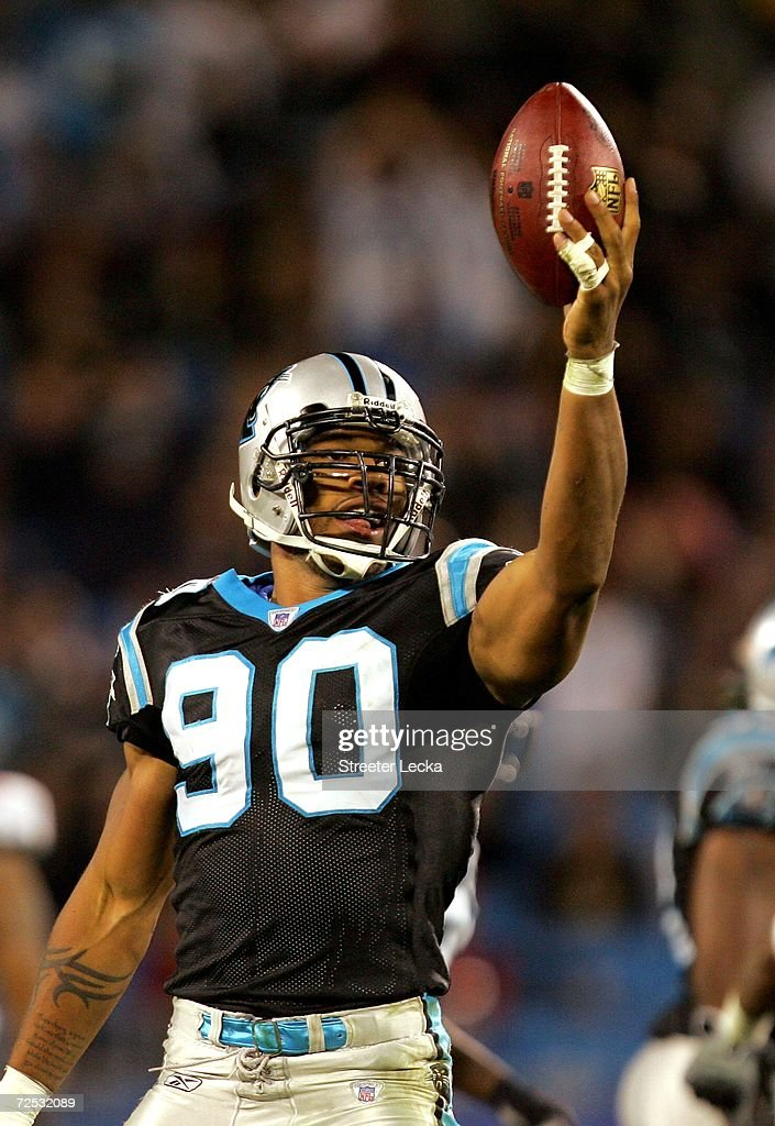 Julius Peppers #90 of the Carolina Panthers celebrates after recovering a fumble during their game against the Tampa Bay Buccaneers on November 13, 2006 at Bank of America Stadium in Charlotte, North Carolina. The Panthers defeated the Bucs 24-10.