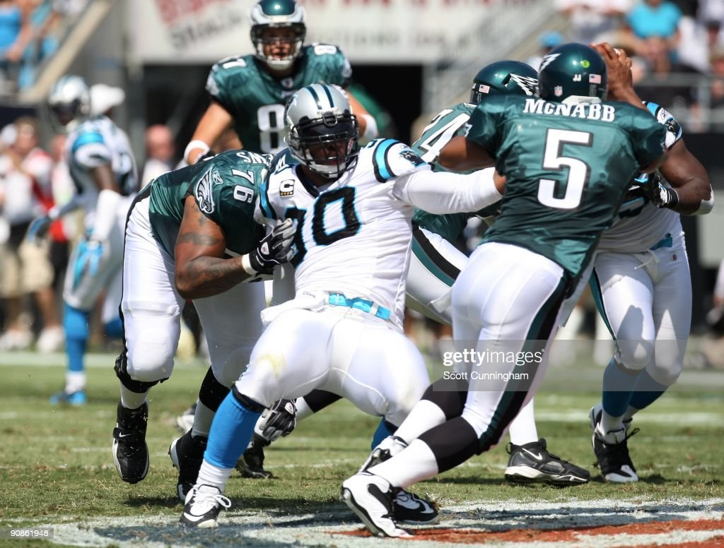 Julius Peppers of the Carolina Panthers rushes against the Philadelphia Eagles at Bank Of America Stadium on September 13 2009 in Charlotte North...