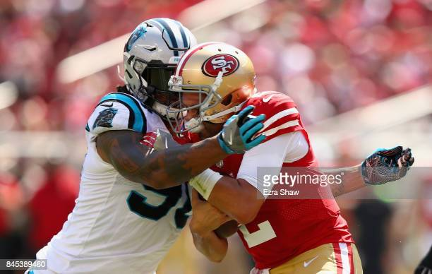 Julius Peppers of the Carolina Panthers tackled Brian Hoyer of the San Francisco 49ers at Levi's Stadium on September 10 2017 in Santa Clara...