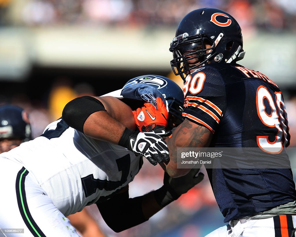 Julius Peppers of the Chicago Bears rushes against Sean Locklear of the Seattle Seahawks at Soldier Field on October 17 2010 in Chicago Illinois The...