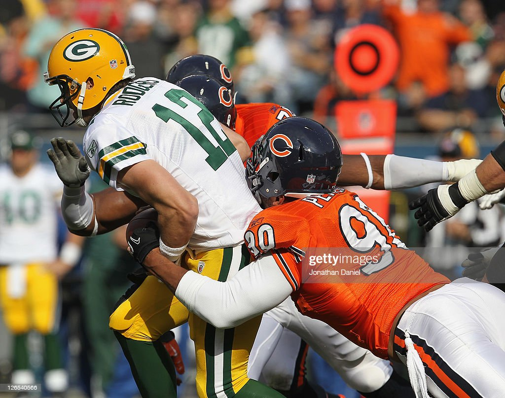 Julius Peppers of the Chicago Bears sacks Aaron Rodgers of the Green Bay Packers at Soldier Field on September 25 2011 in Chicago Illinois